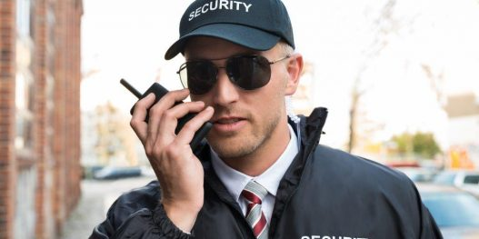 security-guard-talking-on-walkie-talkie_sizel_ddf796