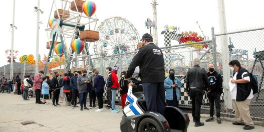 Guests line up on the first day of the Coney Island parks reopening, during the coronavirus disease (COVID-19) pandemic, in the Coney Island neighborhood of Brooklyn, New York, U.S., April 9, 2021.  REUTERS/Brendan McDermid